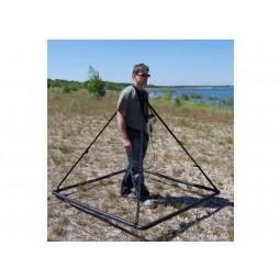 Man using pyramid antenna with OKM Black Hawk R3 Complete Kit Metal Detector