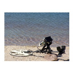 OKM Black Hawk R3 Complete Kit Metal Detector resting on sand near water