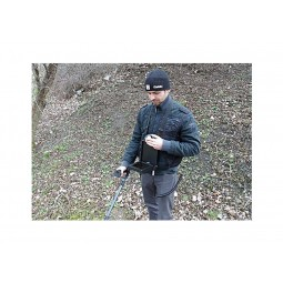 Man looking at digital screen while using OKM eXp 4500 Professional Plus Complete Package Metal Detector