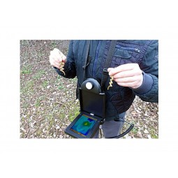 Man holding gold found using OKM EXp 4500 Professional Plus Complete Package Metal Detector