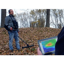 Two men using OKM eXp 6000 Professional Plus Metal Detector and looking at touchscreen