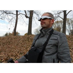 Man using Android video eye glasses with OKM eXp 6000 Professional Plus Metal Detector