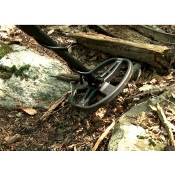 "Garrett CSI Pro - All Terrain Metal Detector 5x8"" DD PROformance Search Coil hovering above forest floor"