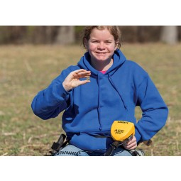 Woman in a blue sweatshirt using a Garrett ACE 200 metal detector to find coins