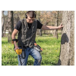 Man wearing ClearSound Easy Stow Headphones using Garrett Ace 300 Metal Detector in forest
