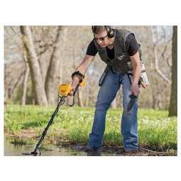 Man using Garrett Ace 300 Metal Detector in a stream wearing ClearSound Easy Stow Headphones