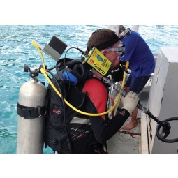 Scuba diver on boat with Garrett Sea Hunter Mark II Metal Detector on his shoulder