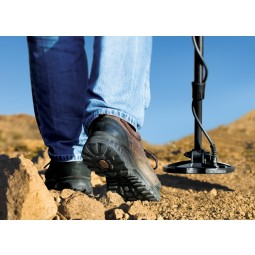 Closeup of boots and search coil on Nokta Makro Multi Kruzer Metal Detector