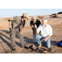 Three men observing a find discovered while using Nokta Makro FORS Gold+ Metal Detector