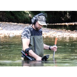 Man holding Nokta Makro ANFIBIO 14 Metal Detector while waist high in stream
