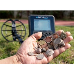 Man holding treasure found with Nokta Makro ANFIBIO Multi Metal Detector
