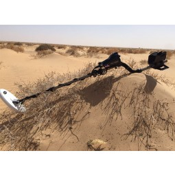 Nokta Makro AU Gold Finder Metal Detector resting in sandy hills in Africa