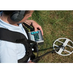 Birds eye view of man using Lorenz Deepmax Z1 Metal Detector while wearing headphones