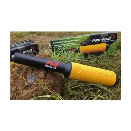 Minelab Pro-Find 15 Pinpointer laying in dirt and grass