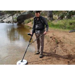 Minelab GPZ 7000 Metal Detector being used on a still water shoreline