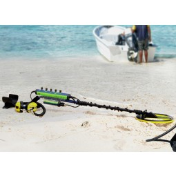 Minelab Excalibur II Metal Detector on the beach shore with boat in the background