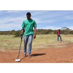 Two men using Minelab Gold Monster 1000 Metal Detector in African plains