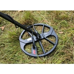 Serach coil on Minelab Equinox 600 Metal Detector resting in grassy
