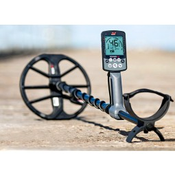 Minelab Equinox 800 Metal Detector resting on a sandy beach