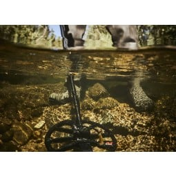 Minelab Equinox 800 Metal Detector coil submerged under river water