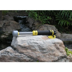 Treasure Products Vibra-Quatic 320 Waterproof Pinpointer resting on a rock in front of waterfall