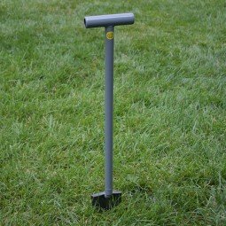 "Lesche Sampson 31"" T-Handle Shovel upright in green grass"