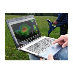 Person holding laptop receiving 3D underground images from OKM Rover C4 Metal Detector