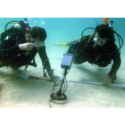JW Fishers Pulse 8x Version 1 Metal Detector being used underwater by a scuba diver