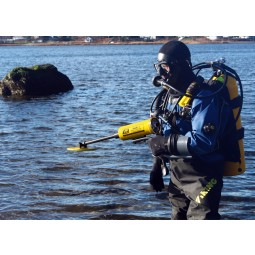 Scuba diver above water using JW Fishers SAR-1 Search and Recovery Metal Detector
