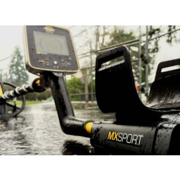 White's MX Sport Waterproof Detector resting in the rain on concrete