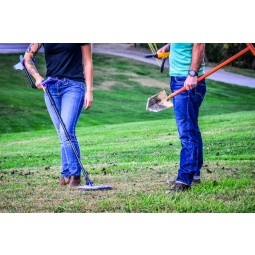 Couple using Striker Detectors z60 Metal Detector and White's Ground Hawg shovel