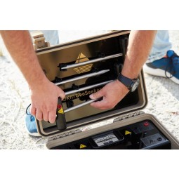 Man pulling OKM GeoSeeker Mini Water and Cavity Detector electrodes out of carrying case