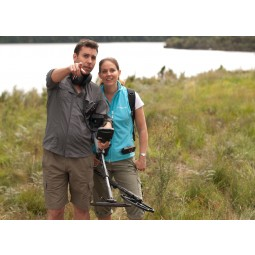 Man and woman pointing into distance while holding Minelab CTX 3030 Standard Metal Detector with Wireless Headphones