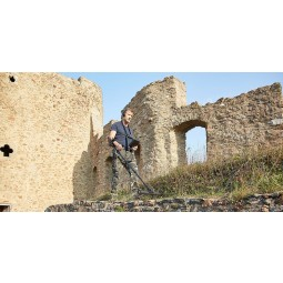 Man using OKM eXp 4500 Professional Metal Detector near ancient stone structure