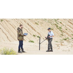 Two men using OKM eXp 6000 Professional Metal Detector near a sandy hillside
