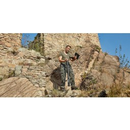 Man standing of rocky hillside using OKM Fusion Professional with Tablet PC