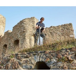 Man standing near ancient ruins using OKM Fusion Professional Plus with Tablet PC