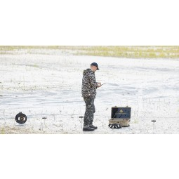 Man looking for water with OKM GeoSeeker Water and Cavefinder in sandy field