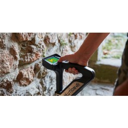 Closeup of hand holding OKM Evolution NTX Metal Detector