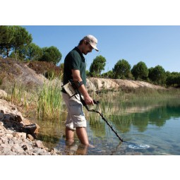 Man using Nokta Makro FORS Gold Metal Detector Pro Package under still waters