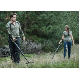 Man and woman in a forest using Minelab GO-FIND 44 metal detectors