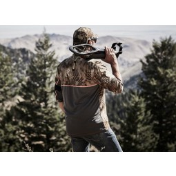 Man overlooking the mountains with Minelab GO-FIND 66 Metal Detector on his shoulder