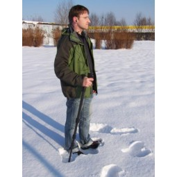 Man in snow using OKM Rover UC Version A Metal Detector
