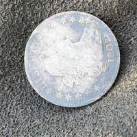 Obverse of 1802 Draped Bust Silver Dime on Textured Dark Gray Background