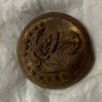 Front of Rusted Button with Eagle Holding Anchor Visible