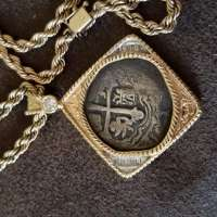 14k Gold Necklace with Old Spanish Coin at Center in the Center on Blue Black Background
